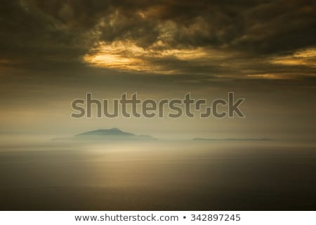 Mist surrounds the Italian islands of Isola d'Ischia and Procida stock photo © Joningall