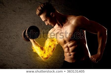 Gespierd bodybuilder gewicht vlammende biceps Stockfoto © ra2studio