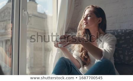 Gyönyörű boldog fiatal nő ül ablakpárkány iszik Stock fotó © deandrobot