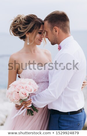 Happy couple kissing on seashore stock photo © konradbak