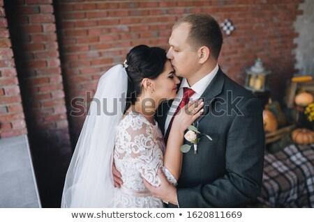 молодые свадьба пару целоваться серый стены Сток-фото © artfotodima