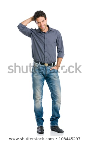 Shy embarrassed young man standing with hands in pockets Stock photo © deandrobot