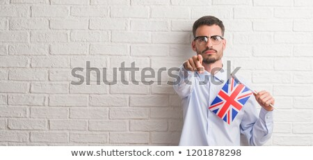 Man standing in front of United Kingdom flag wall Stock photo © stevanovicigor