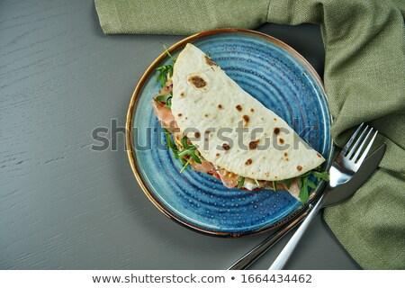 Focaccia bread topped with arugula, tomato and mozzarella, Stock photo © Digifoodstock