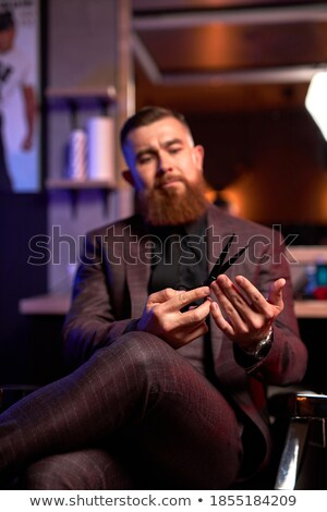 man curled up in an armchair Stock photo © nito