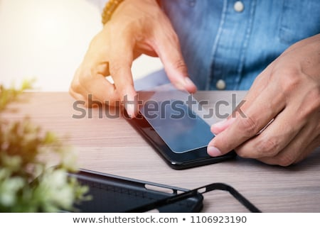 Person Fixing Damaged Screen On Mobile Phone Stock photo © AndreyPopov