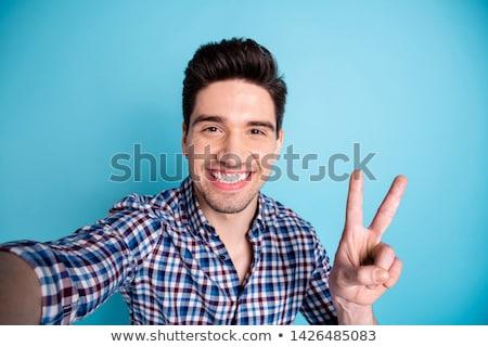 улыбаясь · мужчины · парикмахера · фен · молодые · лице - Сток-фото © deandrobot