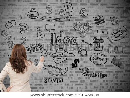 Stock fotó: Businesswoman touching communication and currency icons against wall background