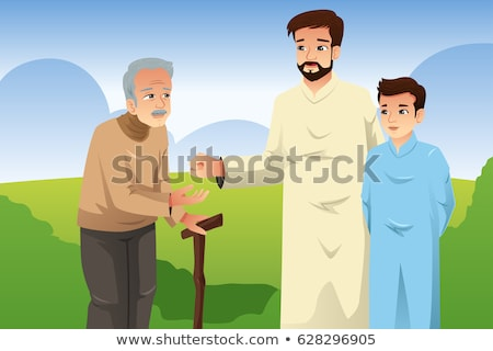 Muslim Father And Son Giving Money To An Old Man Stockfoto © Artisticco