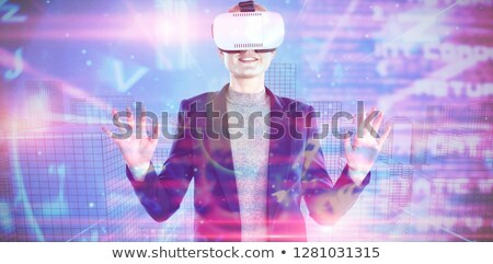 Businesswoman wearing VR glasses while using computer in office 商业照片 © wavebreak_media