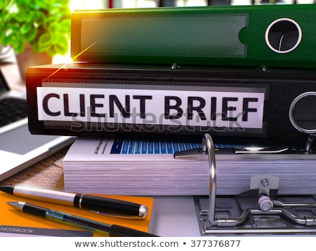 black ring binder with inscription client brief stock photo © tashatuvango
