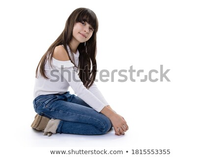 happy brunette girl posing while sitting in studio on floor stock photo © julenochek