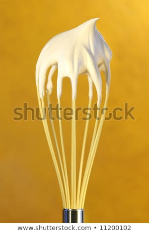 Close up of wire whisk and whipped cream Stock photo © wavebreak_media