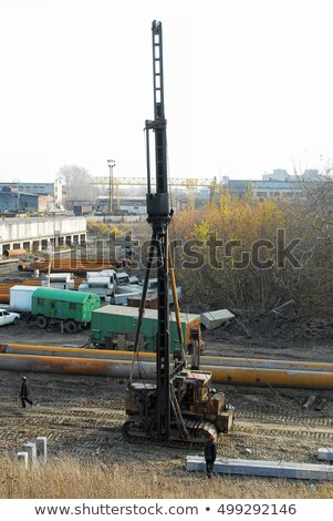 Pile driving machine in construction site. Tyumen Stock photo © Aikon
