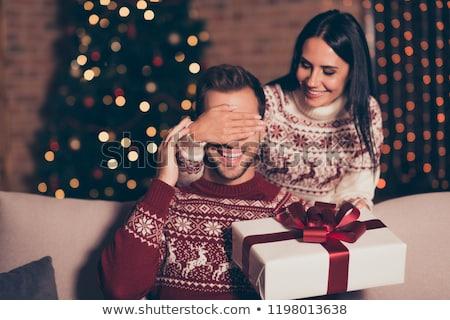 Vrouw verrassend vriendje christmas glimlachende vrouw ogen Stockfoto © LightFieldStudios
