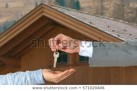 Woman receiving keys to country home Stock photo © IS2