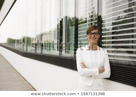 Woman standing in front of buildings Stock photo © IS2