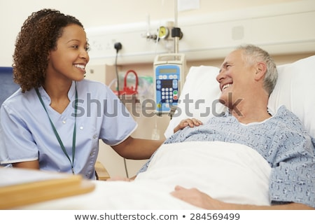Nurse Sitting On Hospital Bed stock photo © monkey_business
