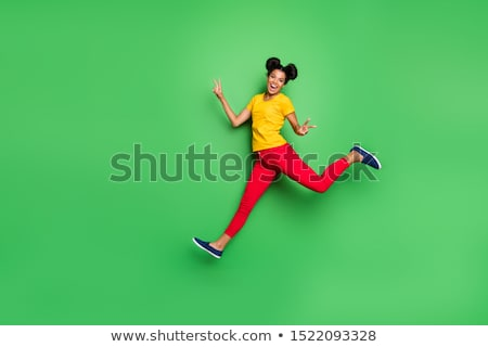 young smiling brunette woman on green background Stock photo © iordani