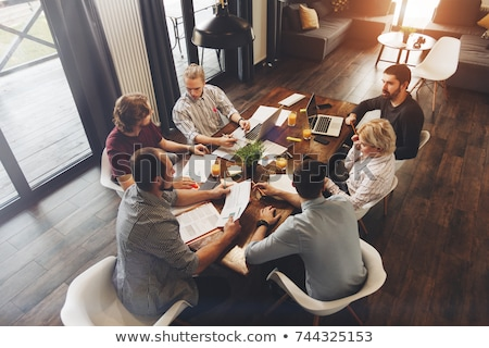 decision making on laptop in conference room stock photo © tashatuvango