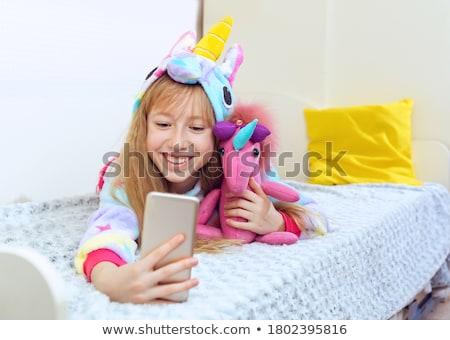 Kid Girl Pajama Unicorn Toy Stock photo © lenm