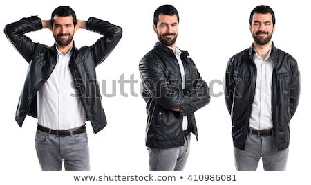 handsome young man in leather jacket is laughing  stock photo © feedough