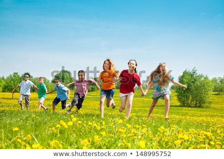Many kids playing and racing in the park Stock photo © bluering