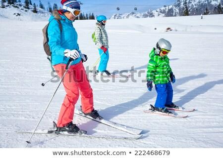 Woman teaching boy to ski Stock photo © IS2