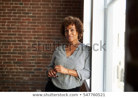 happy smiling middle aged woman at office Stock photo © dolgachov