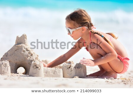 Girls making sandcastles at beach Stock photo © IS2