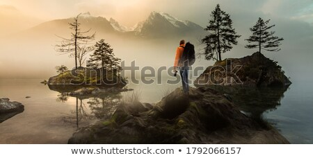 The Photographer Shoots A Magical Sunrise In The Mountains Stock photo © ConceptCafe