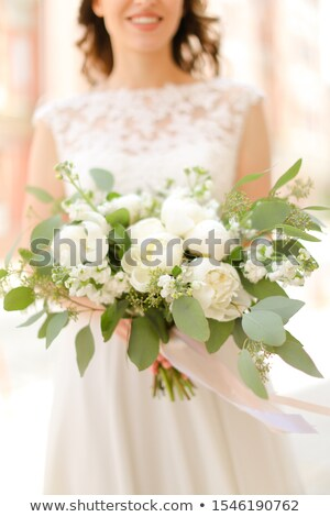 Young pretty bride with bridal bouquet indoors Stock photo © dashapetrenko