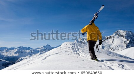 Homme skieur marche montagne neige ski Photo stock © IS2