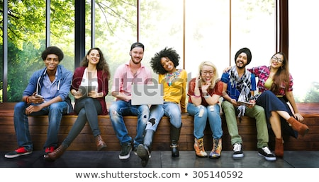 group of friends sitting on tree stock photo © is2