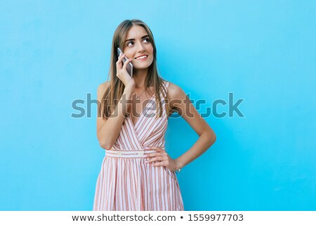 attractive businesswoman laughing while holding hands on hips stock photo © feedough