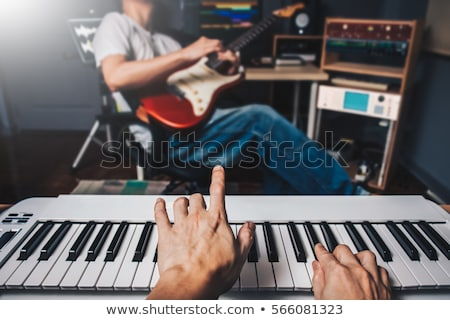 two electric guitar players in studio stock photo © is2