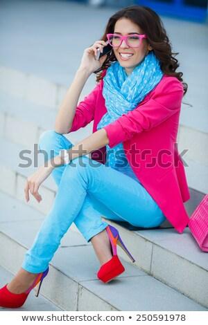красивая женщина макияж прическа сидят ярко одежды Сток-фото © dmitriisimakov