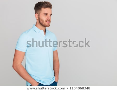 relaxed man wearing light blue polo t shirt looks to side stock photo © feedough