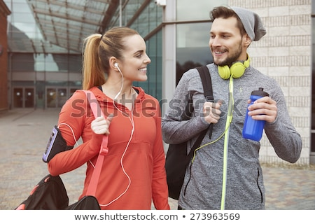 Smiling young sport couple talking Stock photo © deandrobot