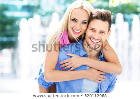 Young happy smiling attractive couple together outdoors Stock photo © konradbak