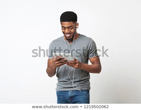 indian · człowiek · słuchanie · muzyki · mężczyzn · słuchawki · młodych - zdjęcia stock © dolgachov