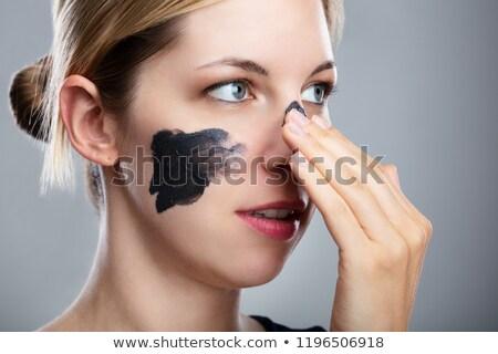 Mulher carvão vegetal máscara cara retrato Foto stock © AndreyPopov