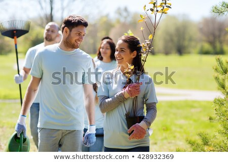 happy volunteers with seedlings and garden tools Stock photo © dolgachov