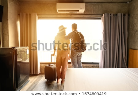 couple checking in to hotel stock photo © kzenon