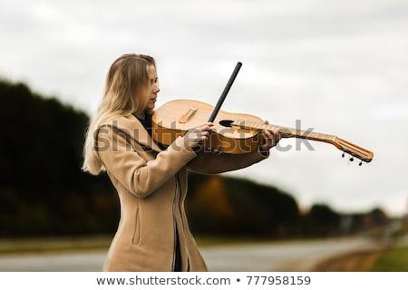 White coat women_classic music Stock photo © toyotoyo