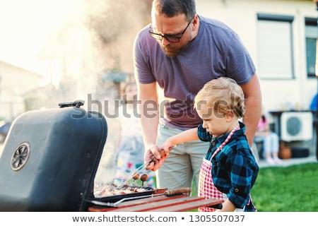 Apa fia főzés hús barbecue grill étel emberek Stock fotó © dolgachov