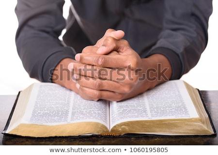 Pregando mano bible luce del sole cadere mani Foto d'archivio © AndreyPopov