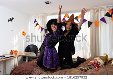 Happy woman witch looking camera and fly on broom Stock photo © deandrobot