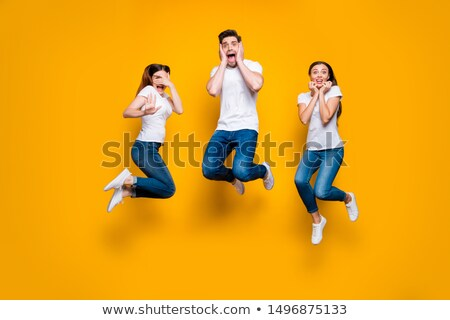 shocked excited young group of friends isolated over white background stock photo © deandrobot