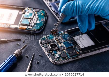 мобильного телефона ремонта рук деревянный стол телефон Сток-фото © OleksandrO